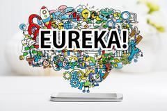 Eureka concept with smartphone Stock Photos