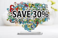 Save 30 percent text with smartphone - stock photo