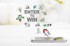 Enter to Win concept with smartphone on white table Stock Photos