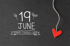 19 June Happy Fathers Day message with paper hearts - stock photo