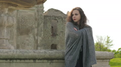 Misteryous woman leaning against marble fontain waiting for somebody Stock Footage