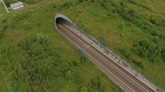 Railraod track and tunnel Stock Footage