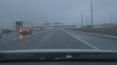Exiting HWY 400 to join ETR HWY 407. Winter evening in Toronto. Stock Footage
