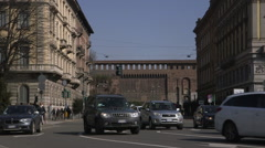 Busy street with cars passing. Sforza walls in background. Milan. Stock Footage