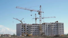 Tower cranes working on the construction site Stock Footage