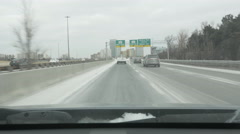 Entering HWY 401 on winter day in Toronto, Canada. Stock Footage