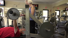 Mature Man Doing Bench Press In Fitness Center Arkistovideo