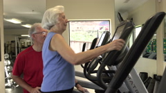 Mature Woman Doing Aerobic Workout In Fitness Center - stock footage