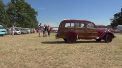 French vintage car - moving old Peugeot 202 Canadian in collector's car meeting Stock Footage