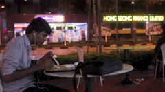 Man Dining Outdoors in Singapore Stock Footage