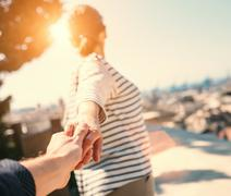 Journey together close up image couple hand taking Stock Photos