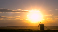 Old Windmill in the Desert Against the Backdrop of the Setting Sun Stock Footage