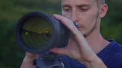 The man use the professional camera with telephoto lens. Real time capture Stock Footage