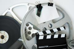 Vintage analog movie reel and clapper - stock photo