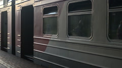 Russian raylways: driving up the train and people entering into the wagons Stock Footage