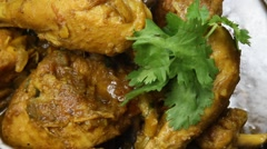 North Indian spicy chicken curry in a skillet Stock Footage