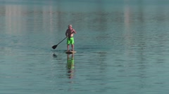 Oceanside paddle boarders - stock footage