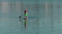 Oceanside paddle boarders Stock Footage