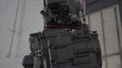 The Engine of the Motorcycle in the Garage on the Hoist Stock Footage