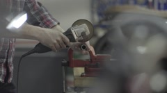 A Man Sawing a Metal Pipe Stock Footage