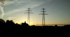 Overhead power line and fields at dusk - stock footage