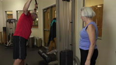 Mature Man Using Exercise Weights In Fitness Center Arkistovideo