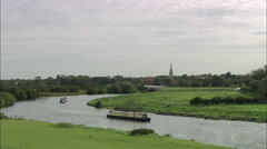 Newark-On-Trent - Reveal From Low Across River And Marina Stock Footage