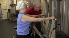 Mature Woman Doing Row Exercise In Fitness Center Stock Footage