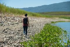 Receding shoreline of the lake Stock Photos