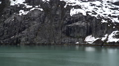 Glacial Rock Reflects over Water Stock Footage