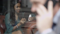 4K Portrait of young woman in cafe making video call Stock Footage