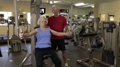 Mature Woman Doing Arm Exercises In Fitness Center Stock Footage