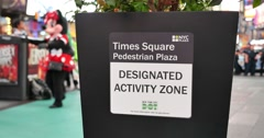Sign Designates Approved Location in Times Square for Costumed Performers to Int - stock footage