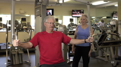 Mature Man Doing Arm Exercises In Fitness Center Stock Footage