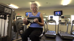Mature Woman Doing Crunches In Fitness Center Stock Footage