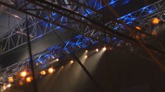 Spotlights and scaffolding at outdoor musical concert. - stock footage