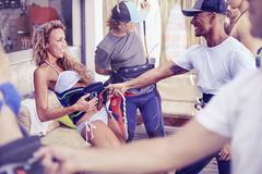 Man teaching woman kiteboarding technique at surf shop Stock Photos