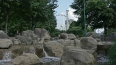 Atlanta Park Waterfall and Ferris Wheel Stock Footage