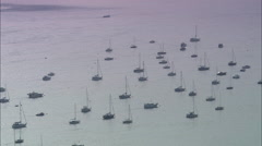 Yachts At Anchor In Glistening Estuary Stock Footage