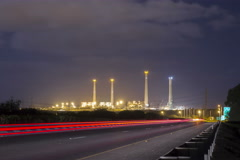 4k Highway and coal power plant night timelapse Stock Footage