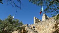 People climbing stairs at Sao Jorge Castle Stock Footage