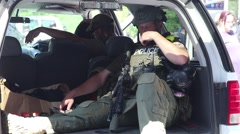 Riot Police in Back of Car Stock Footage