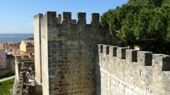 People walking on the wall of Sao Jorge Castle Stock Footage