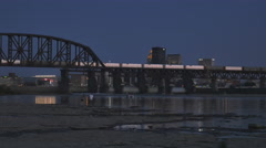 Night Shot Louisville Two People Walking by Ohio River Stock Footage