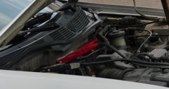 Using Jumper Cables to Jump Battery in White Car 422 10bit, 4K Stock Footage