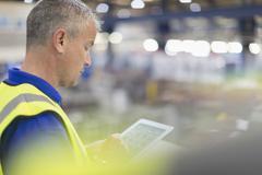 Supervisor using digital tablet in steel factory Stock Photos
