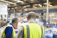 Supervisor and worker in steel factory Stock Photos