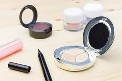 Cosmetic Foundation and Eye Liner and Eyeshadow - stock photo