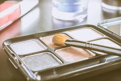 Cosmetics Brush and Palette and Lip Gloss and Eyeshadow Vintage Style Stock Photos