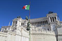 Italian flag at Altare della Patria the Monument to Victor Emmanuel II Rome. Stock Photos